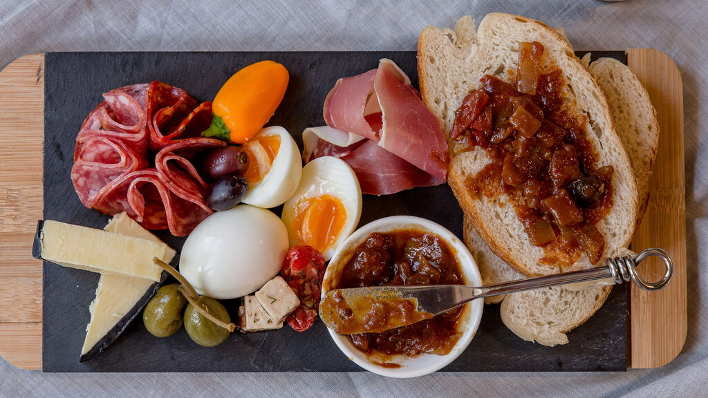 Small charcuterie board featuring our tomato & blueberry chutney